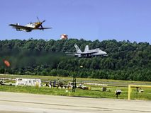 Old and New. A fly-by of a modern f18 and a WWI P51 mustang Stock Photos
