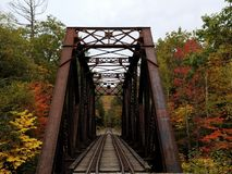 Train trestle in New Hampshire on autumn day royalty free stock photo
