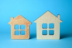 Old and new home. The concept of buying home, the choice of an old house for repair or a new house. How to choose construction stock image