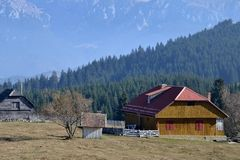 Old and new houses in the mountains. Long, dry autumn in the mountains Piatra Craiului royalty free stock image