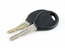 Old and New Keys. A close-up photograph of a new car key resting against an old, very worn car key on a white background Stock Photos