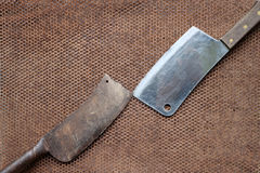 The old and new knife with steel mesh. The old and new knife with steel mesh background Stock Photo
