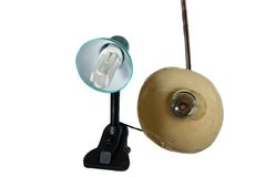 Old and new  lamp. Old and new desk lamp with the same bulbs Royalty Free Stock Photo