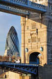 Old & New London Architecture. Juxtaposition of Tower Bridge with Gherkin Building in London, England royalty free stock photos