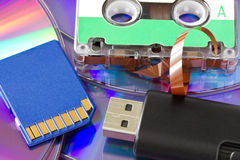 Old and new media storage. Cd, usb,memory card and audio cassette Royalty Free Stock Photo