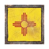 Old New Mexico flag. 3d rendering of a New Mexico State flag over a rusty metallic plate wit a rusty frame. Isolated on white background Stock Image