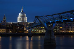 Old & New: Millennium Bridge & St Pauls Cathedral. The modern, 21st century, London Millennium Footbridge Bridge crosses over the River Thames, to St Pauls Stock Images