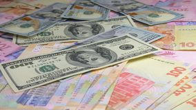 Old and new money dollar and hryvnia is falling on the table. Old and new money dollar is falling on the table stock video footage