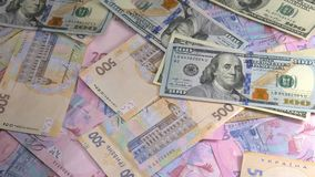 Old and new money dollar and hryvnia is falling on the table. Old and new money dollar and hryvnia is falling on the table stock footage