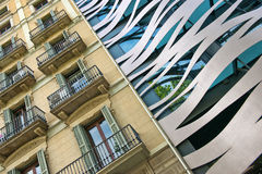 Old and New Neighboring Buildings in Barcelona Stock Photography