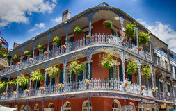 Old New Orleans Building with Balconies and Rails. Old New Orleans Building with Balconies, Rails and Potted Plants Royalty Free Stock Images