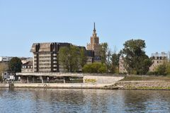 Riga seen from boat on daugava river. Old and new part of Riga seen from boat on daugava river at a sunny summer day stock photography