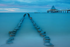 Old and new pier at dusk Royalty Free Stock Image