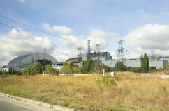 The old and new reactor shelter in Chernobyl nuclear power plant Royalty Free Stock Photo