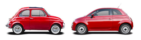 Old and new red Fiat 500. Side view isolated on white Royalty Free Stock Photos