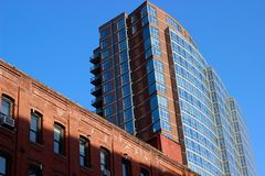 Old and new residence building. Constrast of old and new residence buildings royalty free stock images
