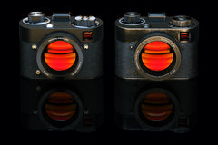 Old and new retro style digital camera isolated on black Royalty Free Stock Photo