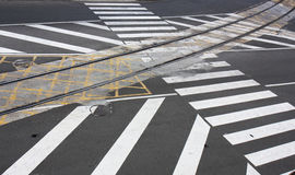 Road marking.Train rails and pedestrian crossing Royalty Free Stock Images
