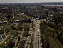 Old and new russian buildings. Aerial view. Old and new russian buildings in green area in the cty with a lot of cars. Zhukovskogo street, Novosibirsk Stock Images