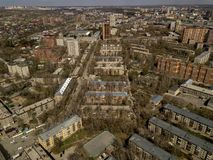 Old and new russian buildings. Aerial view. Old and new russian buildings in green area in the cty with a lot of cars. Zhukovskogo street, Novosibirsk Royalty Free Stock Images