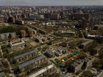 Old and new russian buildings. In green area in the cty with a lot of cars. Zhukovskogo street, Novosibirsk Stock Photos