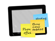Old and new technology - sticky notes and broken computer tablet Stock Images