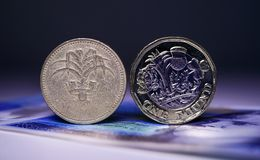 Old Coin, New Coin Version 3 Royalty Free Stock Photos