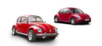 Old and new VW Beetle. Two red VW Beetle the old and the new isolated on white Royalty Free Stock Image