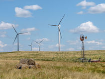 Old and new windmills in a rural pasture Royalty Free Stock Photo