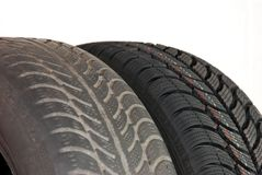 Old and new winter car tires Royalty Free Stock Image