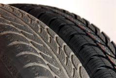 Old and new winter car tires Stock Photos