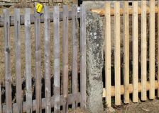 Old and new wooden fence. Czech Republic Royalty Free Stock Photo