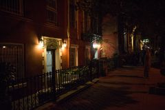 Old New York City Building Porch Lights at Night. Old building lights at night in Manhattan, New York City Stock Photography