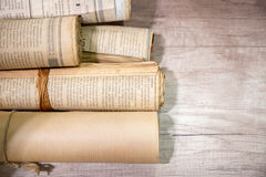 Old newspaper reel. BANGKOK, THAILAND - July 10,2016 : Antique newspaper reels on a wooden table in an antique shop in Bangkok, Thailand Royalty Free Stock Photography