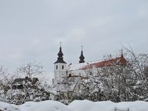 Old beautiful church in winter in Varniai , Lithuania Royalty Free Stock Images