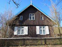 Old wooden home with fence, Lithuania Royalty Free Stock Image