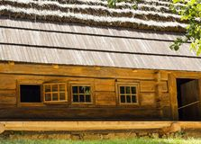 Old nice wooden house with thatched roof Royalty Free Stock Image