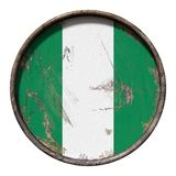 Old Nigeria flag. 3d rendering of a Nigeria flag over a rusty metallic plate. Isolated on white background Royalty Free Stock Images