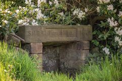 An old nineteenth century stone public drinking well. royalty free stock photo