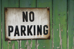 Old no parking sign on garage door Royalty Free Stock Image