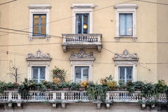 Old noble windows. Balconies and windows of an old mansion from Milan stock photos