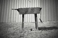 An old noise monochrome photo with brazier. On the ground royalty free stock images