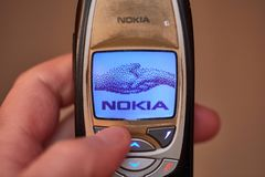 Old Nokia mobile phone. BUDAPEST, HUNGARY - MARCH 01, 2018: Nokia 6310i cellphone showing the nokia welcome screen when starting up. The 6310i was a very popular Royalty Free Stock Photos
