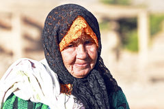 An old nomad woman in the desert Royalty Free Stock Photography
