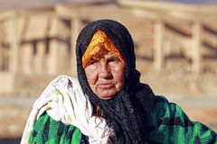 Old nomad woman in the desert Stock Image