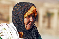 Old nomad woman in the desert Royalty Free Stock Images