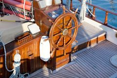 Old nostalgic sail boat - cockpit and rudder of teak wood. Royalty Free Stock Images
