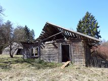 Old not living home in village, Lithuania. Old wooden not living home in village in spring royalty free stock image