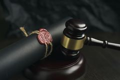 Old notarial wax seal and stamp on judicial table. Old notarial wax seal and stamp on judicial royalty free stock photo