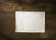Old Note. On a dirty wall. Add your own text Royalty Free Stock Photography